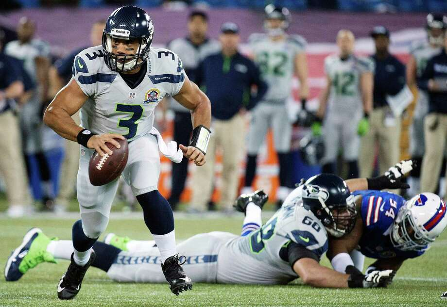 Seattle Seahawks quarterback Russell Wilson (3) runs the ball against the Buffalo Bills during the first the half of an NFL football game in Toronto, Sunday, Dec. 16, 2012. Photo: AP