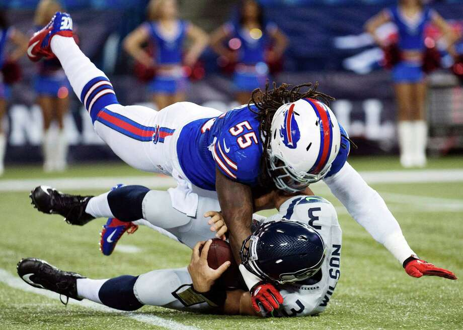Buffalo Bills linebacker Kelvin Sheppard (55) sacks Seattle Seahawks quarterback Russell Wilson (3) during the first the half of an NFL football game in Toronto, Sunday, Dec. 16, 2012. Photo: AP