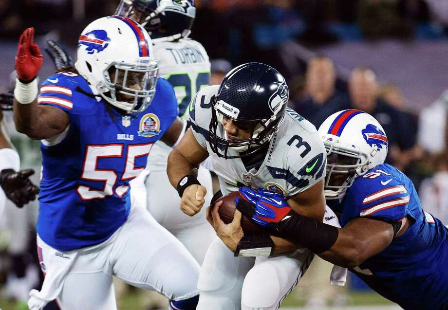 Buffalo Bills linebacker Kelvin Sheppard (55) pursues as defensive end Spencer Johnson (91) sack Seattle Seahawks quarterback Russell Wilson (3) during the first the half of an NFL football game in Toronto, Sunday, Dec. 16, 2012. Photo: AP