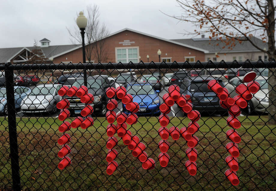 "Cups spell out the word ""pray"" on the fence outside Read Intermediate School in Newtown, the site of grief counseling for the Sandy Hook Elementary School shooting on Sunday, December 16, 2012. Photo: Brian A. Pounds / Connecticut Post"