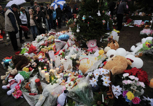 A large memorial for victims of the Sandy Hook Elementary School shooting grows at the intersection of Church Hill Road and Washington Avenue in the Sandy Hook section of Newtown on Sunday, December 16, 2012. Photo: Brian A. Pounds / Connecticut Post