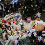 A large memorial for victims of the Sandy Hook Elementary School shooting grows at the intersection of Church Hill Road and Washington Avenue in the Sandy Hook section of Newtown on Sunday, December 16, 2012.