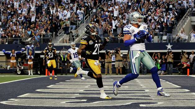Jason Witten #82 of the Dallas Cowboys pulls in a touchdown pass against Robert Golden #21 of the Pittsburgh Steelers at Cowboys Stadium on December 16, 2012 in Arlington, Texas. Photo: Tom Pennington, Getty Images / 2012 Getty Images
