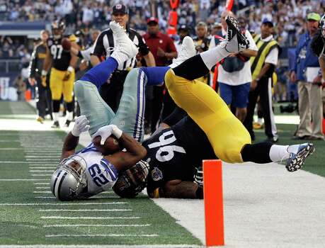 DeMarco Murray #29 of the Dallas Cowboys gets upended by Ziggy Hood #96 of the Pittsburgh Steelers short of the end zone at Cowboys Stadium on December 16, 2012 in Arlington, Texas. Photo: Tom Pennington, Getty Images / 2012 Getty Images