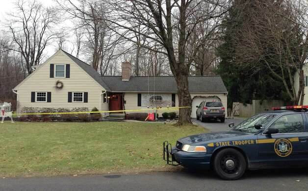 Crime scene tape surrounds the home at 20 Bri-Lan Ave. on Sunday, Dec. 16, 2012 in Schodack, NY.  State Police are investigating the stabbing death of a 33-year-old realtor who lived on Bri Lan Avenue, and have taken her estranged boyfriend into custody.  (Paul Buckowski / Times Union) Photo: Paul Buckowski