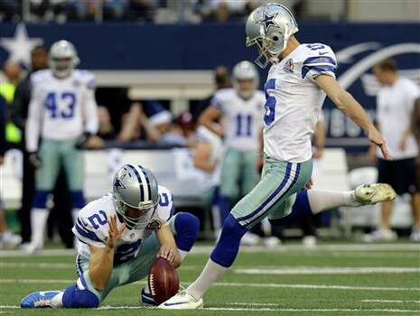 As Dallas Cowboys punter Brian Moorman (2) holds, kicker Dan Bailey (5) makes a field goal against the Pittsburgh Steelers during the first half of an NFL football game Sunday, Dec. 16, 2012 in Arlington, Texas. (AP Photo/LM Otero) Photo: LM Otero, Associated Press / AP