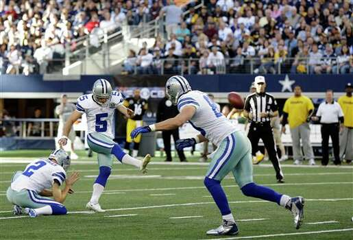 As Dallas Cowboys punter Brian Moorman (2) holds, kicker Dan Bailey (5) makes a field goal against the Pittsburgh Steelers during the first half of an NFL football game Sunday, Dec. 16, 2012 in Arlington, Texas. (AP Photo/Tony Gutierrez) Photo: Tony Gutierrez, Associated Press / AP