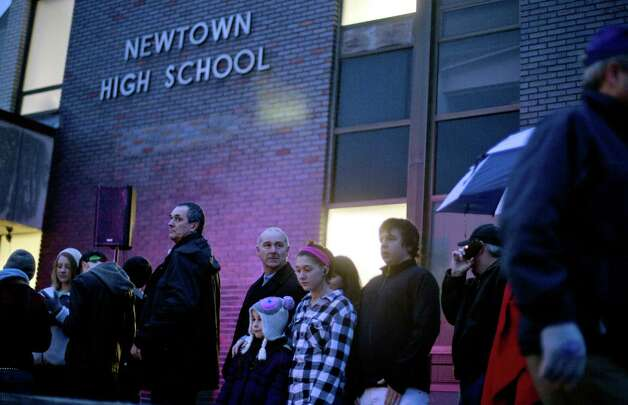 People wait in line to enter Newtown High School for a memorial vigil attended by President Barack Obama for the victims of the Sandy Hook Elementary School shooting, Sunday, Dec. 16, 2012, in Newtown, Conn. (AP Photo/David Goldman) Photo: AP