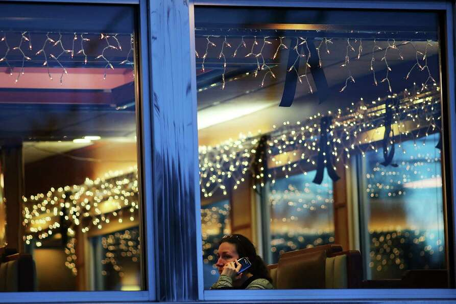 NEWTOWN, CT - DECEMBER 15:  A woman speaks on the phone at a diner near Sandy Hook elementary school