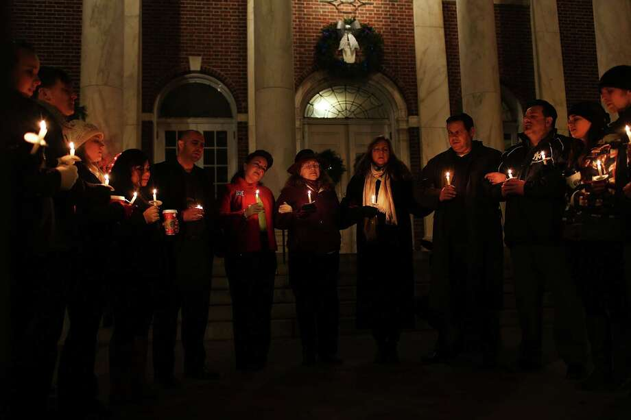 NEWTOWN, CT - DECEMBER 15:  People attend a candlelight vigil to reflect on the violence at the Sandy Hook School at a church on December 15, 2012 in Newtown, Connecticut. Twenty-six people were shot dead, including twenty children, after a gunman identified as Adam Lanza opened fire at Sandy Hook Elementary School. Lanza also reportedly had committed suicide at the scene. A 28th person, believed to be Nancy Lanza was found dead in a house in town, was also believed to have been shot by Adam Lanza.  (Photo by Spencer Platt/Getty Images) Photo: Spencer Platt, Getty Images / Getty Images