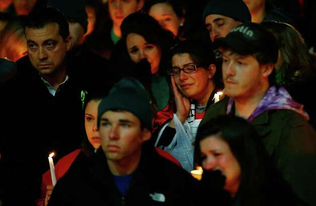 STRATFORD, CT - DECEMBER 15: People mourn the loss of Victoria Soto, the first-grade teacher at Sandy Hook Elementary School who was shot and killed while protecting her students, during a candlelight vigil at Stratford High School on December 15, 2012 in Stratford, Connecticut. Twenty-six people were shot dead, including twenty children, after a gunman identified as Adam Lanza opened fire in the school. Lanza also reportedly had committed suicide at the scene. A 28th person, believed to be Nancy Lanza was found dead in a house in town, was also believed to have been shot by Adam Lanza. (Photo by Jared Wickerham/Getty Images) Photo: Jared Wickerham, Getty Images / Getty Images