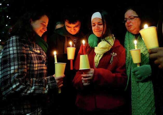 STRATFORD, CT - DECEMBER 15: Donna Soto (R), mother of Victoria Soto, the first-grade teacher at Sandy Hook Elementary School who was shot and killed while protecting her students, mourns with her daughter Karly (second from right), daughter Jillian (far left) and son Matthew Soto (second from left), at a candlelight vigil at Stratford High School on December 15, 2012 in Stratford, Connecticut. Twenty-six people were shot dead, including twenty children, after a gunman identified as Adam Lanza opened fire in the school. Lanza also reportedly had committed suicide at the scene. A 28th person, believed to be Nancy Lanza was found dead in a house in town, was also believed to have been shot by Adam Lanza. (Photo by Jared Wickerham/Getty Images) Photo: Jared Wickerham, Getty Images / Getty Images