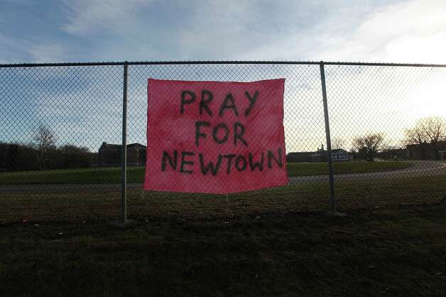 NEWTOWN, CT - DECEMBER 15:  A handwritten sign reads 'Pray for Newtown' following the mass shooting at Sandy Hook Elementary School December 15, 2012 in Newtown, Connecticut. Twenty six people were shot dead, including twenty children, after a gunman identified as Adam Lanza opened fire in the school. Lanza also rep