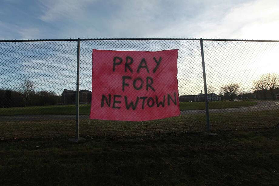 NEWTOWN, CT - DECEMBER 15:  A handwritten sign reads 'Pray for Newtown' following the mass shooting at Sandy Hook Elementary School December 15, 2012 in Newtown, Connecticut. Twenty six people were shot dead, including twenty children, after a gunman identified as Adam Lanza opened fire in the school. Lanza also reportedly had committed suicide at the scene. A 28th person, believed to be Nancy Lanza was found dead in a house in town, was also believed to have been shot by Adam Lanza.  (Photo by Mario Tama/Getty Images) Photo: Mario Tama, Getty Images / Getty Images