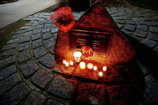 STRATFORD, CT - DECEMBER 15: Candles are lit and flowers are left outside of Stratford High School during a candlelight vigil in honor of Victoria Soto, the first-grade teacher at Sandy Hook Elementary School who was shot and killed while protecting her students, on December 15, 2012 in Stratford, Connecticut. Twenty-six people were shot dead, including twenty children, after a gunman identified as Adam Lanza opened fire in the school. Lanza also reportedly had committed suicide at the scene. A 28th person, believed to be Nancy Lanza was found dead in a house in town, was also believed to have been shot by Adam Lanza. (Photo by Jared Wickerham/Getty Images) Photo: Jared Wickerham, Getty Images / Getty Images