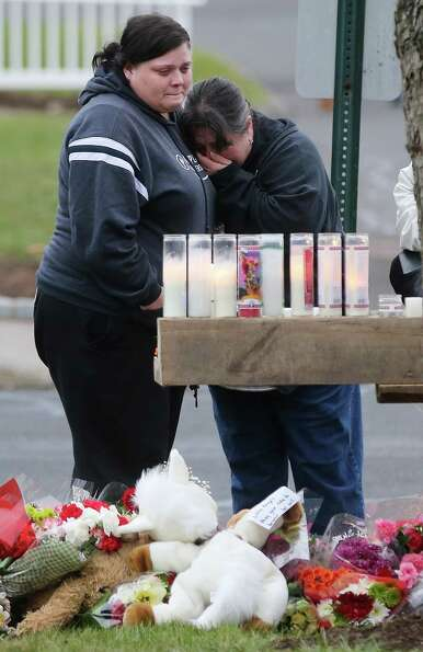 NEWTOWN, CT - DECEMBER 16:  Mourners view a makeshift memorial outside St. Rose of Lima Roman Cathol