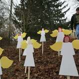 NEWTOWN, CT - DECEMBER 16:  Eric Mueller places twenty seven wooden angles he made in his yard down the street from the Sandy Hook School December 16, 2012 in Newtown, Connecticut. Twenty-six people were shot dead, including twenty children, after a gunman identified as Adam Lanza opened fire at Sandy Hook Elementary School. Lanza also reportedly had committed suicide at the scene. A 28th person, believed to be Nancy Lanza was found dead in a house in town, was also believed to have been shot by Adam Lanza.  (Photo by Spencer Platt/Getty Images)
