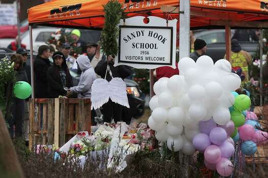 NEWTOWN, CT - DECEMBER 16:  Flowers and balloons are left on display in front of the Sandy Hook School December 16, 2012 in Newtown, Connecticut. Twenty-six people were shot dead, including twenty children, after a gunman identified as Adam Lanza opened fire at Sandy Hook Elementary School. Lanza also reportedly had committed suicide at the scene. A 28th person, believed to be Nancy Lanza, found dead in a house in town, was also believed to have been shot by Adam Lanza.  (Photo by Spencer Platt/Getty Images) Photo: Spencer Platt, Getty Images / Getty Images