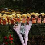 NEWTOWN, CT - DECEMBER 16: Teddy bears and flowers, in memory of those killed, are left at a memorial down the street from the Sandy Hook School December 16, 2012 in Newtown, Connecticut. Twenty-six people were shot dead, including twenty children, after a gunman identified as Adam Lanza opened fire at Sandy Hook Elementary School. Lanza also reportedly had committed suicide at the scene. A 28th person, believed to be Nancy Lanza, found dead in a house in town, was also believed to have been shot by Adam Lanza.  (Photo by Spencer Platt/Getty Images)
