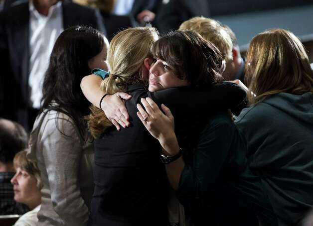 Residents greet each other before an interfaith vigil for the victims of the Sandy Hook Elementary School shooting on Sunday, Dec. 16, 2012 at Newtown High School in Newtown, Conn.  A gunman walked into Sandy Hook Elementary School Friday and opened fire, killing 26 people, including 20 children.  (AP Photo/ Evan Vucci) Photo: AP
