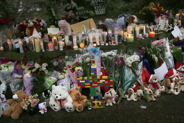 NEWTOWN, CT - DECEMBER 16:  Teddy bears, flowers and candles in memory of those killed, are left at a memorial down the street from the Sandy Hook School December 16, 2012 in Newtown, Connecticut. Twenty-six people were shot dead, including twenty children, after a gunman identified as Adam Lanza opened fire at Sandy Hook Elementary School. Lanza also reportedly had committed suicide at the scene. A 28th person, believed to be Nancy Lanza, found dead in a house in town, was also believed to have been shot by Adam Lanza.  (Photo by Spencer Platt/Getty Images) Photo: Spencer Platt, Getty Images / Getty Images