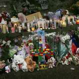 NEWTOWN, CT - DECEMBER 16:  Teddy bears, flowers and candles in memory of those killed, are left at a memorial down the street from the Sandy Hook School December 16, 2012 in Newtown, Connecticut. Twenty-six people were shot dead, including twenty children, after a gunman identified as Adam Lanza opened fire at Sandy Hook Elementary School. Lanza also reportedly had committed suicide at the scene. A 28th person, believed to be Nancy Lanza, found dead in a house in town, was also believed to have been shot by Adam Lanza.  (Photo by Spencer Platt/Getty Images)