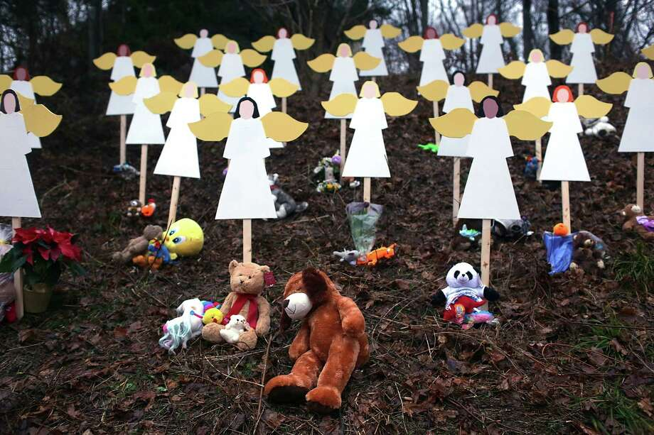 NEWTOWN, CT - DECEMBER 16:  Twenty seven wooden stand in a yard down the street from the Sandy Hook School December 16, 2012 in Newtown, Connecticut. Twenty-six people were shot dead, including twenty children, after a gunman identified as Adam Lanza opened fire at Sandy Hook Elementary School. Lanza also reportedly had committed suicide at the scene. A 28th person, believed to be Nancy Lanza, found dead in a house in town, was also believed to have been shot by Adam Lanza.  (Photo by Spencer Platt/Getty Images) Photo: Spencer Platt, Getty Images / Getty Images