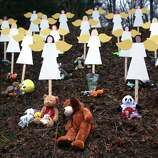 NEWTOWN, CT - DECEMBER 16:  Twenty seven wooden stand in a yard down the street from the Sandy Hook School December 16, 2012 in Newtown, Connecticut. Twenty-six people were shot dead, including twenty children, after a gunman identified as Adam Lanza opened fire at Sandy Hook Elementary School. Lanza also reportedly had committed suicide at the scene. A 28th person, believed to be Nancy Lanza, found dead in a house in town, was also believed to have been shot by Adam Lanza.  (Photo by Spencer Platt/Getty Images)