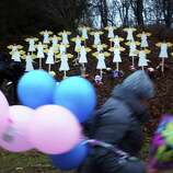 NEWTOWN, CT - DECEMBER 16: Twenty seven wooden angles stand in a yard down the street from the Sandy Hook School December 16, 2012 in Newtown, Connecticut. Twenty-six people were shot dead, including twenty children, after a gunman identified as Adam Lanza opened fire at Sandy Hook Elementary School. Lanza also reportedly had committed suicide at the scene. A 28th person, believed to be Nancy Lanza, found dead in a house in town, was also believed to have been shot by Adam Lanza.  (Photo by Spencer Platt/Getty Images)