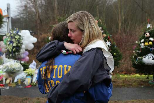 NEWTOWN, CT - DECEMBER 16:  Kristen Brassard (Left) and Kat Donohue, both of Newtown, hug outside of the Sandy Hook School December 16, 2012 in Newtown, Connecticut. Twenty-six people were shot dead, including twenty children, after a gunman identified as Adam Lanza opened fire at Sandy Hook Elementary School. Lanza also reportedly had committed suicide at the scene. A 28th person, believed to be Nancy Lanza, found dead in a house in town, was also believed to have been shot by Adam Lanza.  (Photo by Spencer Platt/Getty Images) Photo: Spencer Platt, Getty Images / Getty Images