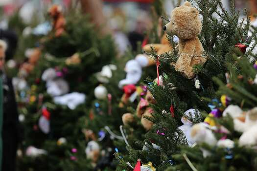 NEWTOWN, CT - DECEMBER 16: Stuffed animals decorate Christmas trees donated in memory of those killed at the  Sandy Hook School December 16, 2012 in Newtown, Connecticut. Twenty-six people were shot dead, including twenty children, after a gunman identified as Adam Lanza opened fire at Sandy Hook Elementary School. Lanza also reportedly had committed suicide at the scene. A 28th person, believed to be Nancy Lanza, found dead in a house in town, was also believed to have been shot by Adam Lanza.  (Photo by Spencer Platt/Getty Images) Photo: Spencer Platt, Getty Images / Getty Images