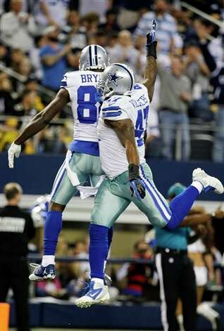 Dallas Cowboys wide receiver Dez Bryant (88) celebrates his touchdown against the Pittsburgh Steelers with Lawrence Vickers (47) during the second half of an NFL football game Sunday, Dec. 16, 2012 in Arlington, Texas. (AP Photo/Tony Gutierrez) Photo: Tony Gutierrez, Associated Press / AP