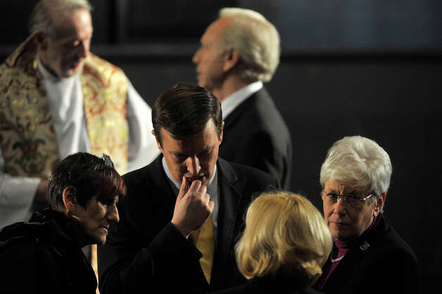 Sen.-elect Chris Murphy, center, and Lieutenant Gov. Nancy Wyman, right, greet people before President Barack Obama speaks in the Newtown High School auditorium on Sunday, Dec. 16, 2012. Photo: Jason Rearick / The News-Times