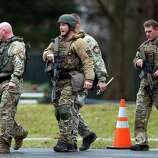Connecticut State Police officers respond to a bomb threat outside of St. Rose of Lima Roman Catholic Church, Sunday, Dec. 16, 2012, in Newtown, Conn. Worshippers hurriedly left the church Sunday, not far from where a gunman opened fire Friday inside the Sandy Hook Elementary School in Newtown. (AP Photo/Julio Cortez)