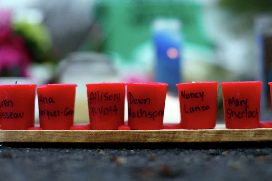 Candles with the names of shooting victims written on them sit at a memorial near Sandy Hook Elementary School, Sunday, Dec. 16, 2012 in Newtown, Conn.  A gunman walked into Sandy Hook Elementary School in Newtown Friday and opened fire, killing 26 people, including 20 children. (AP Photo/Jason DeCrow) Photo: Jason DeCrow, Associated Press / Associated Press