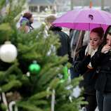 Two girls pause at the site of a makeshift memorial for school shooting victims at the village of Sandy Hook in Newtown, Conn., Sunday, Dec. 16, 2012. A gunman opened fire at Sandy Hook Elementary School in the town, killing 26 people, including 20 children before killing himself on Friday. (AP Photo/Charles Krupa)
