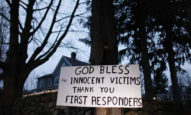 A message of thanks and prayer is displayed outside a home in the wake of a deadly school shooting, Sunday, Dec. 16, 2012, in Newtown, Conn.  A gunman walked into Sandy Hook Elementary School in Newtown on Friday and opened fire, killing 26 people, including 20 children. (AP Photo/Jason DeCrow) Photo: Jason DeCrow, Associated Press