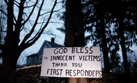 A message of thanks and prayer is displayed outside a home in the wake of a deadly school shooting, Sunday, Dec. 16, 2012, in Newtown, Conn.  A gunman walked into Sandy Hook Elementary School in Newtown on Friday and opened fire, killing 26 people, including 20 children. (AP Photo/Jason DeCrow) Photo: Jason DeCrow, Associated Press / Associated Press