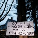 A message of thanks and prayer is displayed outside a home in the wake of a deadly school shooting, Sunday, Dec. 16, 2012, in Newtown, Conn.  A gunman walked into Sandy Hook Elementary School in Newtown on Friday and opened fire, killing 26 people, including 20 children. (AP Photo/Jason DeCrow)