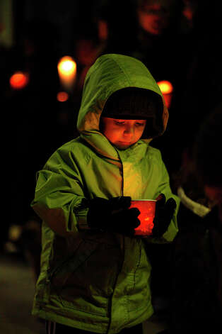 Ome Zuniga, 5, holds a candle outside Oasis Charter School in Salinas, Calif. on Saturday, Dec. 15, 2012, during a vigil for the victims of the school massacre in Newtown, Conn. (AP Photo/ Monterey County Herald, David Royal) Photo: David Royal, Associated Press / Associated Press