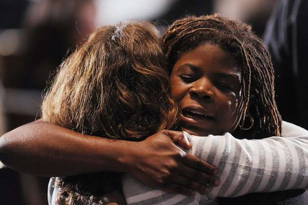 NEWTOWN, CT - DECEMBER 16:  Mourners comfort one another before U.S. President Barack Obama speaks at an interfaith vigil for the shooting victims from Sandy Hook Elementary School on December 16, 2012 at Newtown High School in Newtown, Connecticut. Twenty-six people were shot dead, including twenty children, after a gunman identified as Adam Lanza opened fire at Sandy Hook Elementary School. Lanza also reportedly had committed suicide at the scene. A 28th person, believed to be Nancy Lanza, found dead in a house in town, was also believed to have been shot by Adam Lanza. (Photo by Olivier Douliery-Pool/Getty Images) Photo: Pool, Getty Images