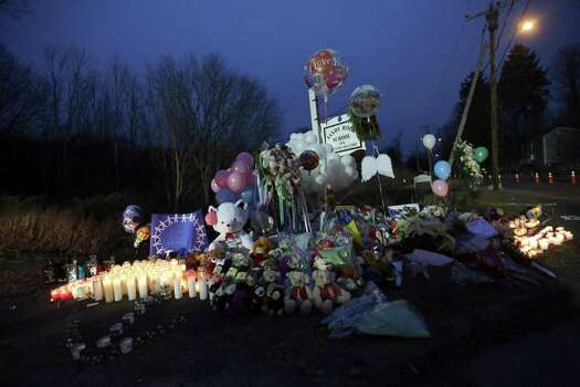 Candles, balloons, stuffed animals and personal notes are placed on a memorial for the victims of the Sandy Hook Elementary School shooting, Sunday, Dec. 16, 2012, in the Sandy Hook village of Newtown, Conn. A gunman walked into Sandy Hook Elementary School in Newtown Friday and opened fire, killing 26 people, including 20 children. (AP Photo/Mary Altaffer) Photo: Mary Altaffer, Associated Press / Associated Press