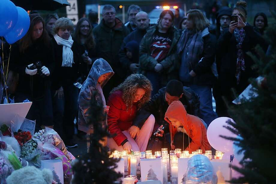 NEWTOWN, CT - DECEMBER 16:  People gather at a memorial for victims near the school on the first Sunday following the mass shooting at Sandy Hook Elementary School on December 16, 2012 in Newtown, Connecticut. U.S. President Barack Obama visited the grief stricken town today.  (Photo by Mario Tama/Getty Images) Photo: Mario Tama, Getty Images