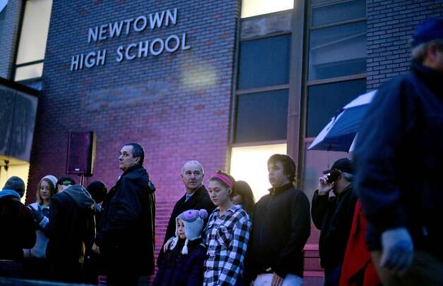 People wait in line to enter Newtown High School for a memorial vigil attended by President Barack Obama for the victims of the Sandy Hook Elementary School shooting, Sunday, Dec. 16, 2012, in Newtown, Conn. (AP Photo/David Goldman) Photo: Contributed Photo, AP
