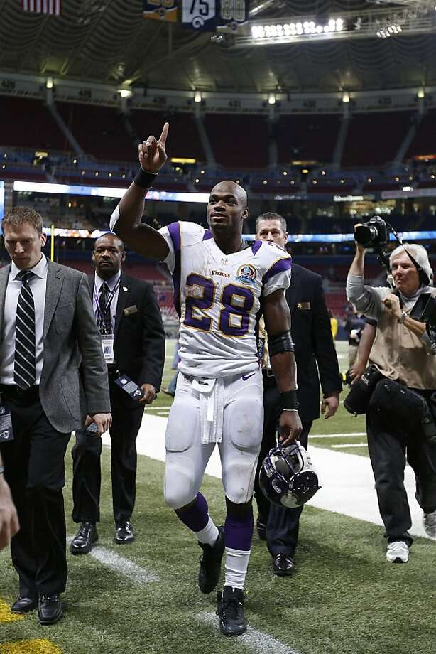 Running back Adrian Peterson gestures toward fans after the Vikings defeated the Rams 36-22 at Edward Jones Dome in St. Louis. Peterson ran for 212 yards. Photo: Joe Robbins, Getty Images