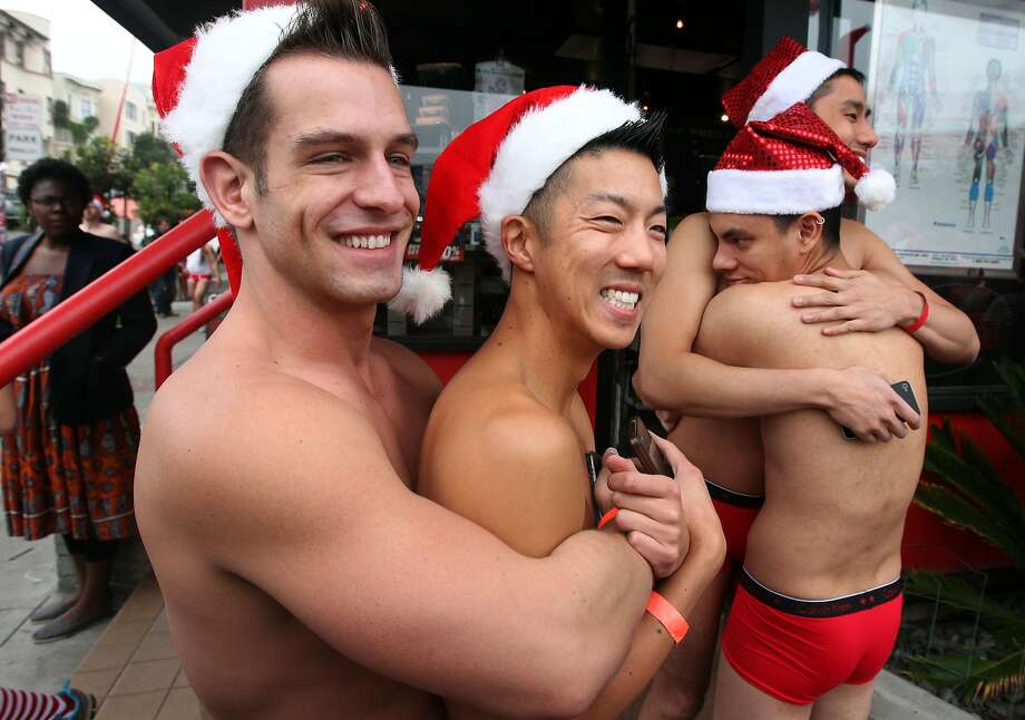From left, runners Brandon Bartell, David Chu, Chris Tipton-King and Walter Turner try to stay warm prior to the start of the annual Santa Skivvies Run Sunday, Dec. 16, 2012. Four hundred volunteers and joggers took part, raising $43,000 for the AIDS Foundation. Runners started at the Lookout Bar on Market Street then ran through the Castro District taking a spontaneous route, much to the delight of onlookers. Photo: Lance Iversen, The Chronicle