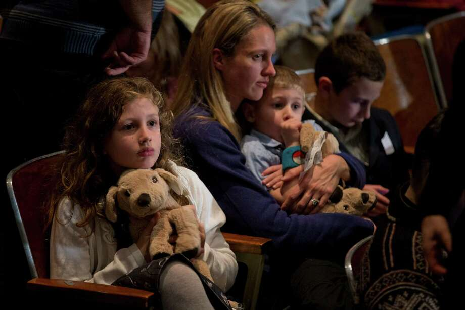 Residents wait for the start of an interfaith vigil for the victims of the Sandy Hook Elementary School shooting on Sunday, Dec. 16, 2012 at Newtown High School in Newtown, Conn. A gunman walked into Sandy Hook Elementary School Friday and opened fire, killing 26 people, including 20 children. (AP Photo/Evan Vucci) Photo: AP