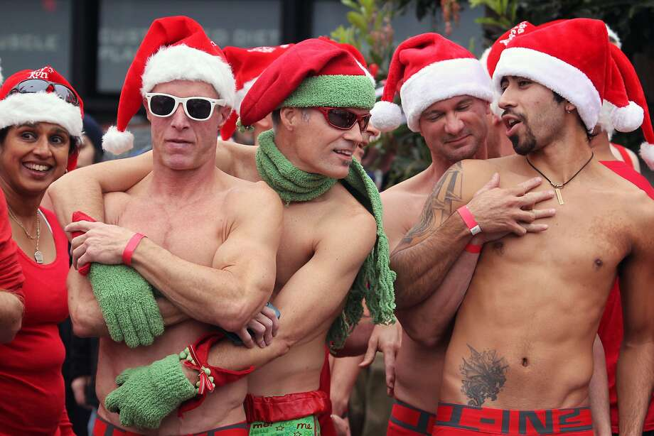 Runners in the annual Santa Skivvies Run try to stay warm prior to the start Sunday, Dec. 16, 2012. Four hundred volunteers and joggers took part, raising $43,000 for the AIDS Foundation. Runners started at the Lookout Bar on Market Street then ran through the Castro District taking a spontaneous route, much to the delight of onlookers. Photo: Lance Iversen, The Chronicle