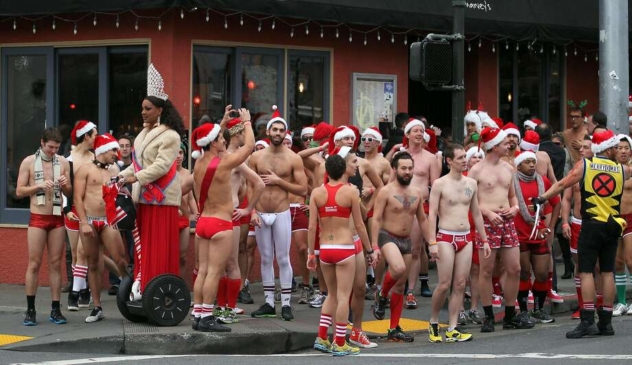 Runners wait for a light to change on Castro Street during the annual Santa Skivvies Run Sunday, Dec. 16, 2012. Four hundred volunteers and joggers took part in the annual event that raised $43,000 for the San Francisco AIDS Foundation. Photo: Lance Iversen, The Chronicle