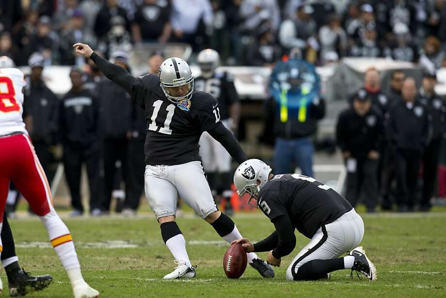 OAKLAND, CA - DECEMBER 16: Kicker Sebastian Janikowski #11 of the Oakland Raiders kicks a field goal off a hold from Shane Lechler #9 during the second quarter against the Kansas City Chiefs at O.co Coliseum on December 16, 2012 in Oakland, California. Photo by Jason O. Watson/Getty Images) Photo: Jason O. Watson, Getty Images